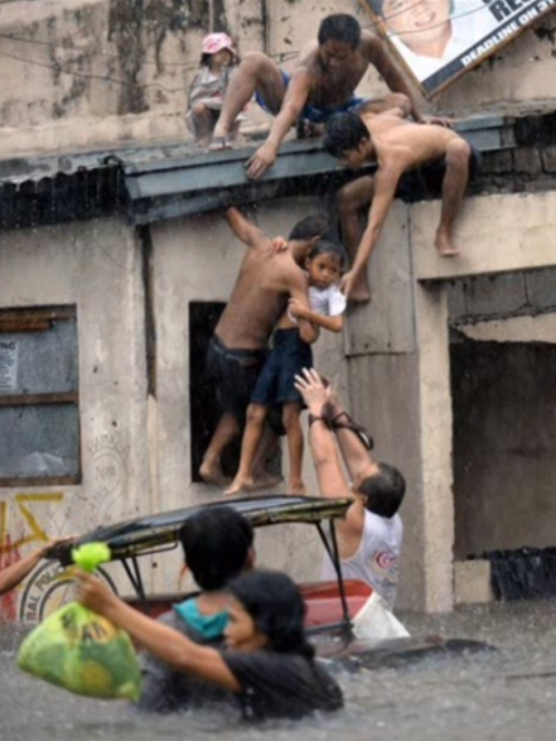 People Helping Each Other: Photo Of People Helping Each Other In A Typhoon Leads To A